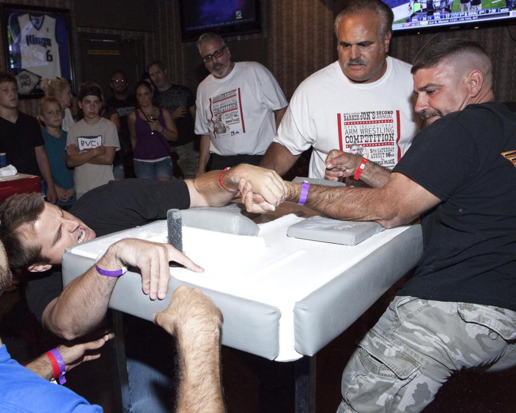 ... Barber Jon?s owner, Jon Rivera, who hosted the arm wrestling